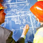 builders-reviewing-plans