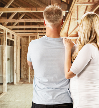 couple-looking-at-construction
