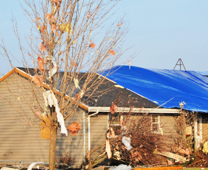 wind-damage-tarp-on-roof